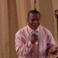 pastor Akim preaching